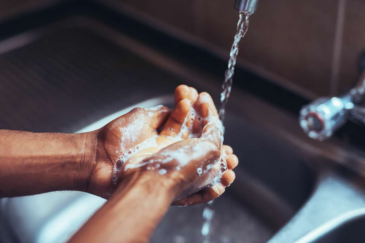 First, wash your hands with soap and warm water to get rid of any oil on your fingers.