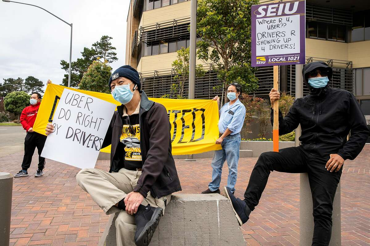 From left: Paifu Juan, Francis Shwe, Sein Lin and Than Myint with We Drive Progress, an organizing group for Lyft and Uber drivers, rally and distribute masks to ride-share drivers on Friday, June 12, 2020, in San Francisco, Calif.