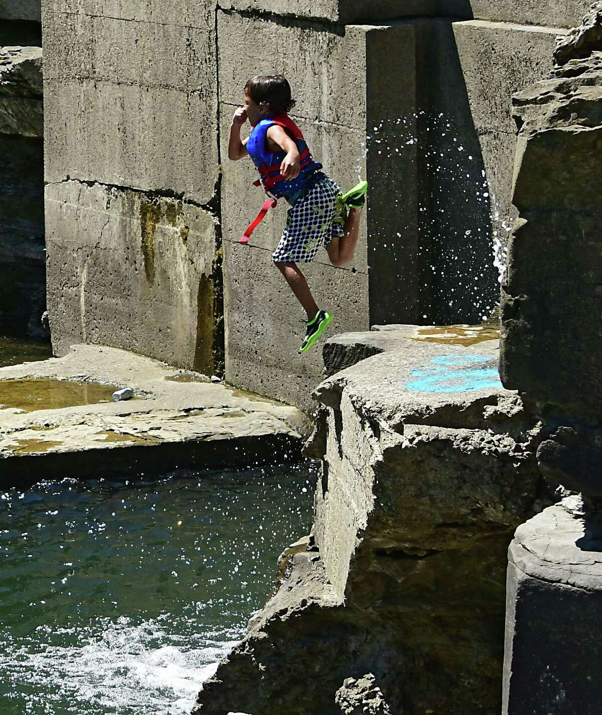 Jaeden Randoph, 7, of Schenectady cools off by jumping off a cliff into the water below at French's Hollow Falls on Wednesday, June 24, 2020 in Guilderland, N.Y. (Lori Van Buren/Times Union)