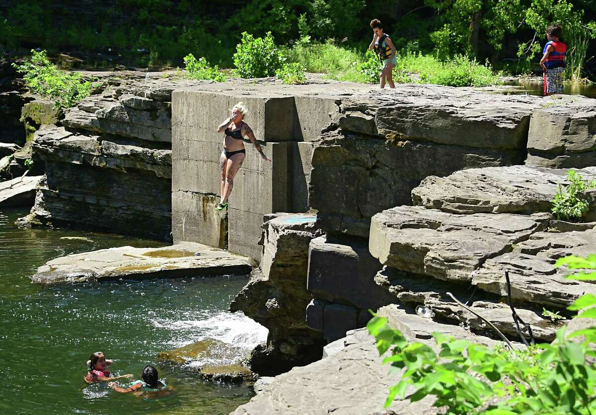 Kayla Randoph of Schenectady cools off by jumping off a cliff into the water below at French's Hollow Falls on Wednesday, June 24, 2020 in Guilderland, N.Y. (Lori Van Buren/Times Union)