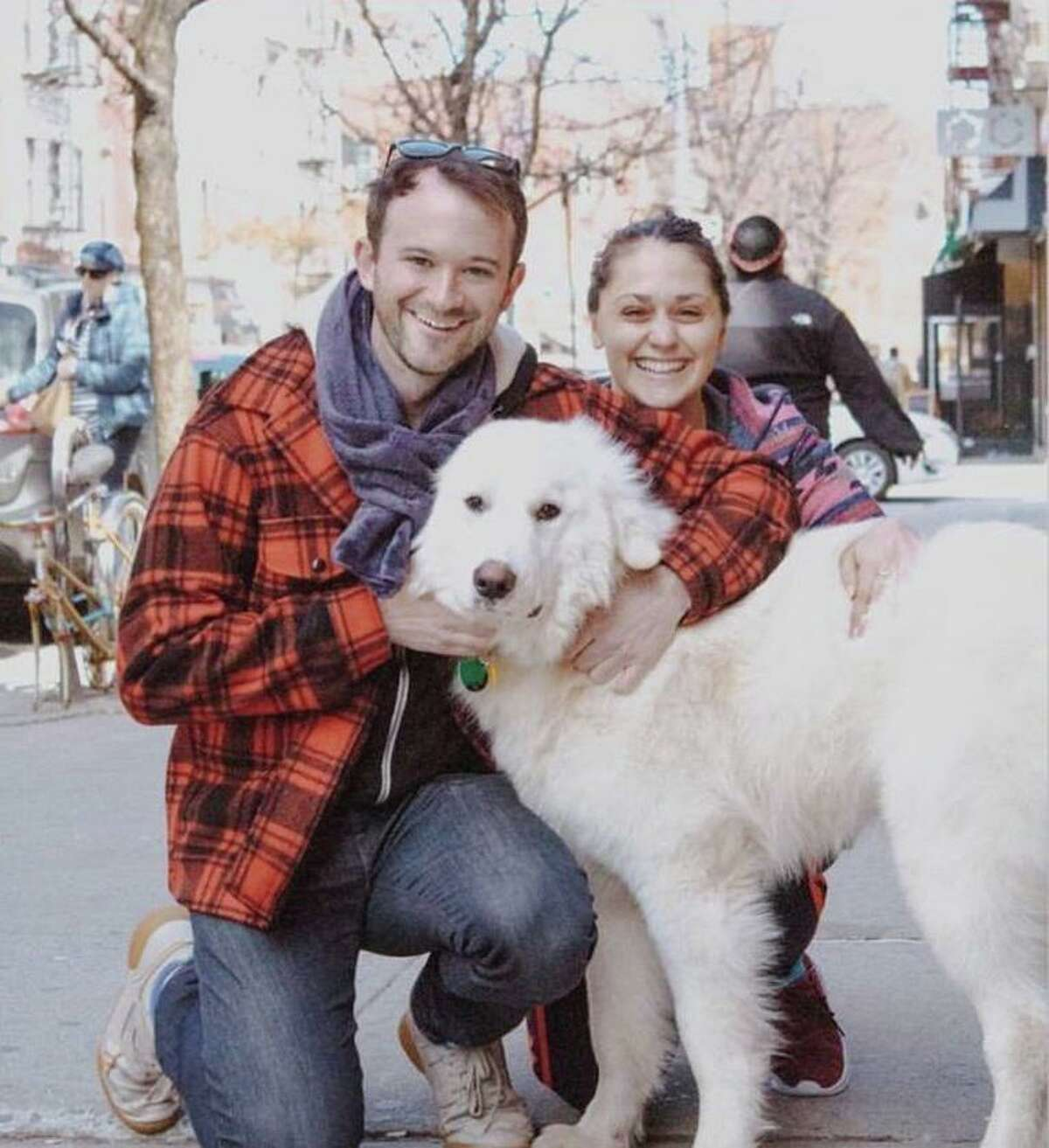 """Luther James """"Luke"""" Smith and Lily Rebecca Robinson with their dog, Winston."""