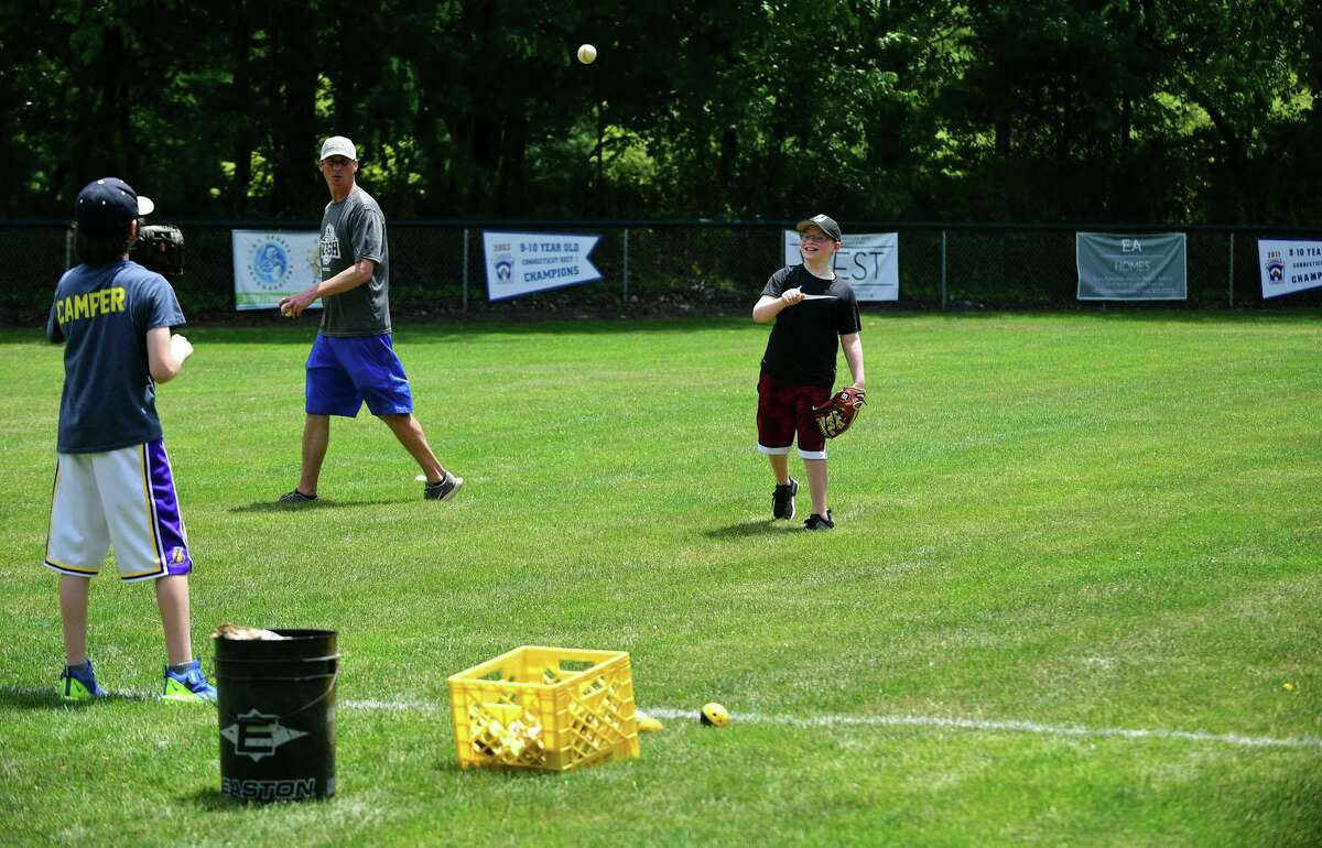 A Youth Baseball Clinic is taking place on Town Fields on Wednesday, June 24, 2020, in Westport, Connecticut.  The city announced that the sports fields are now open to the general public.