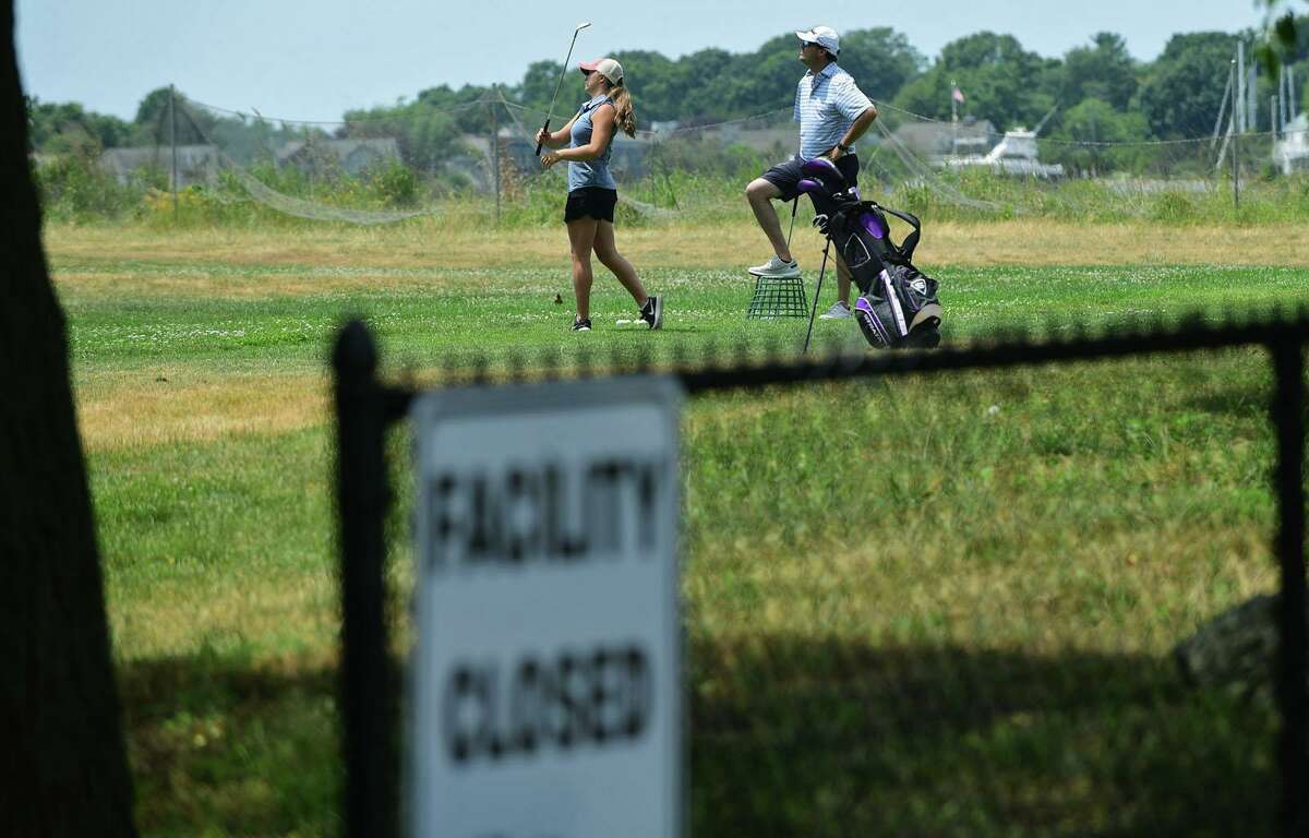 Residents practice golf at Longshore Park on Wednesday, June 24, 2020, in Westport, Connecticut.  The city announced that the sports fields are now open to the general public.