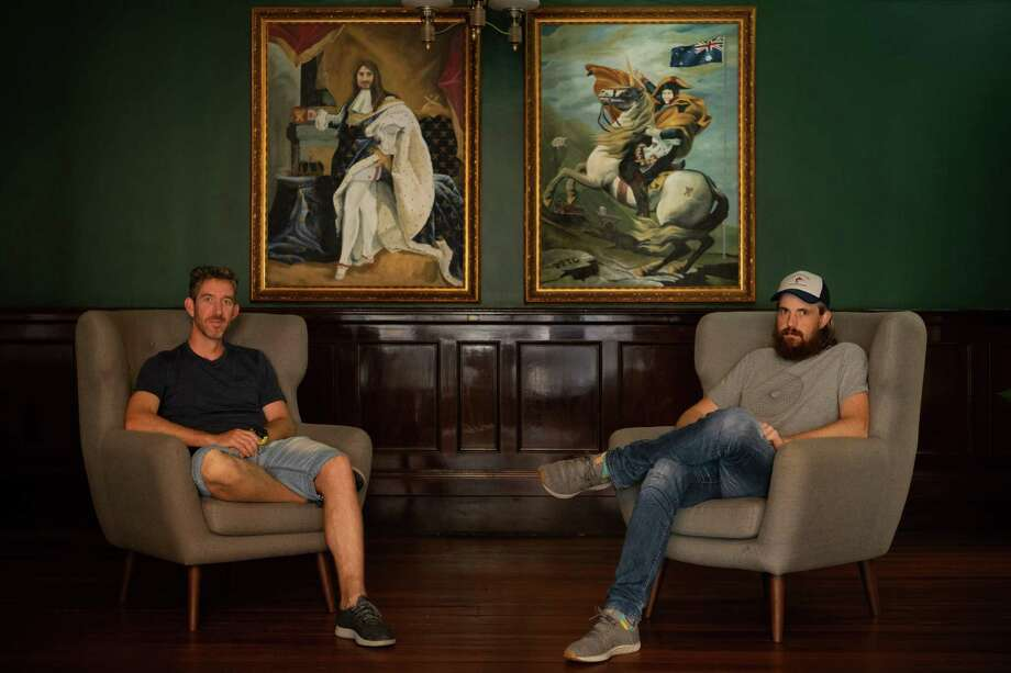High-profile investors including Atlassian co-founder Mike Cannon-Brookes, right, have backed an Australian project that seeks to slash the costs of sucking carbon dioxide from the atmosphere by using microscopic fungi. Scott Farquhar, left, and Cannon-Brookes are pictured at the Sydney headquarters of their company in January 2019. Photo: MATTHEW ABBOTT, STR / NYT / NYTNS