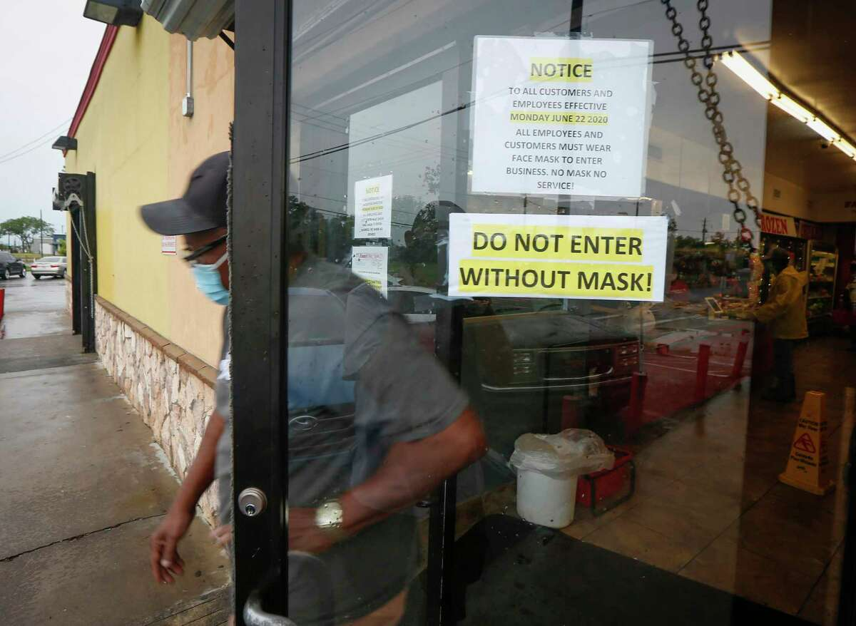 Patrons exit Farmer's Fresh Meat, Farmer's Fresh Meat, 8630 Cullen Blvd. after Harris County Judge Lina Hidalgo issued an order mandating that businesses in the county must require customers wear masks to slow the spread of the novel coronavirus Monday, June 22, 2020, in Houston.