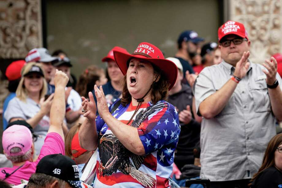 Trump supporters sing as they wait near the BOK Center in Tulsa, Okla., on Saturday, where the president held his first campaign rally since March 2. Few supporters wore masks at his rally. Photo: Erin Schaff /New York Times / NYTNS