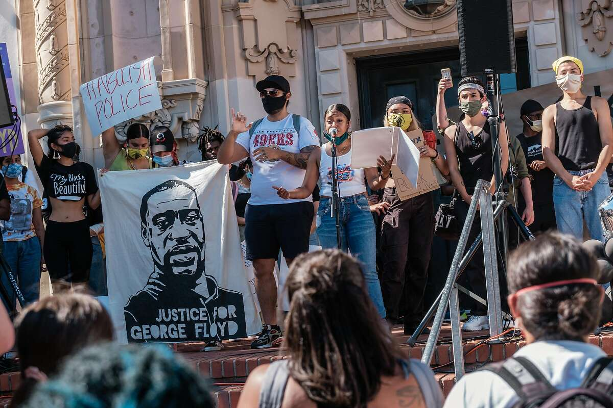 Student organizer Simone Jacques addresses the crowd before a student led George Floyd march in San Francisco on Wednesday, June 3, 2020.