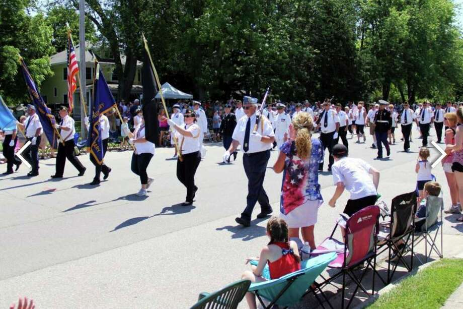 Scenes from last year's Fourth of July parade in Port Austin. This year's parade is planned to feature a 30-foot by 50-foot American flag. (Tribune File Photo)
