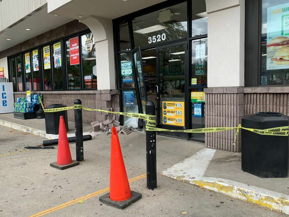 The Marathon/Next Door Food Store located at 3520 Isabella Street was heavily damaged when a car crashed through the building's front doors Wednesday morning, June 24, 2020. Photo: Fred Kelly/fred.kelly@mdn.net