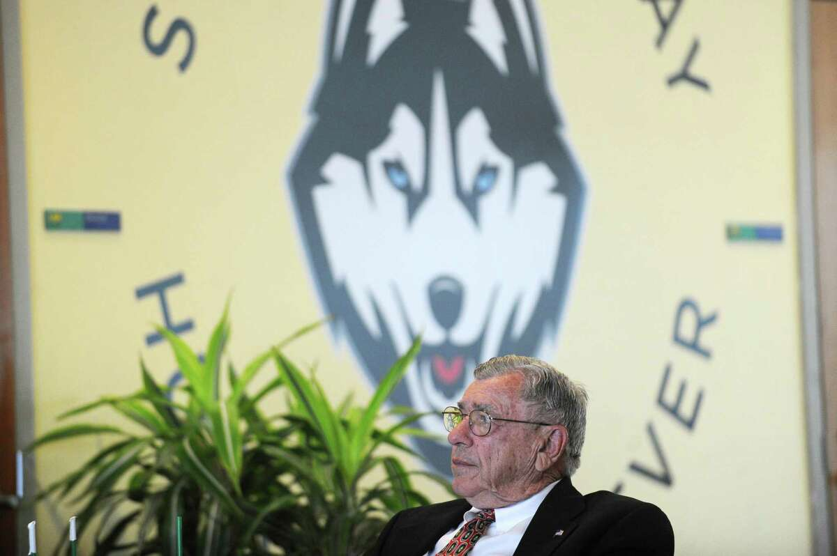 John Kuczo, of Stamford, listens to executive director Tom Chiappetta list of his accomplishments during the ceremony announcing the 2018 inductees to the Fairfield County Sports Hall of Fame inside UConn Stamford in downtown Stamford, Conn. on Wednesday, June 20, 2018. Kuczo, who was a track and field coach at Rippowam High School before working with the FCIAC for 30 as executive secretary, also spoke on behalf of his late father Paul Kuczo Sr., who will also be inducted.