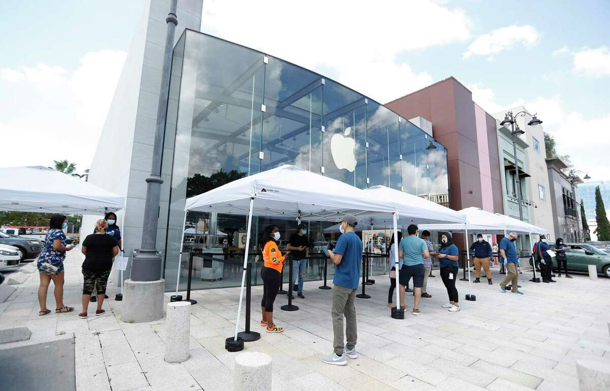 Apple set up tents to screen customers, as customers lined up at Highland Village Apple Store, in Houston, Wednesday, May 27, 2020, as Apple opened up for the first time since the pandemic. Due to deteriorating conditions in the region, Houston-area stores are being reclosed temporarily.
