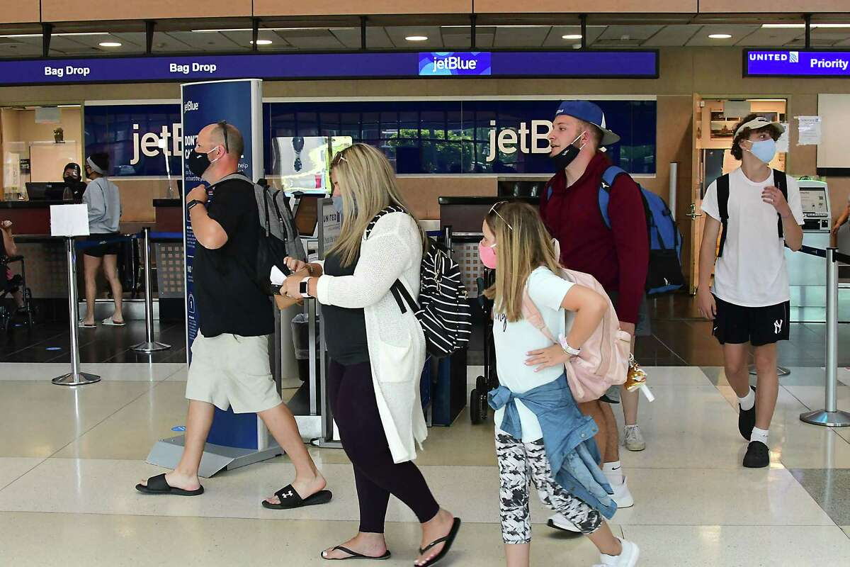 The CDC said fully vaccinated people could travel safely, although they should still wear face masks, practice social distancing, and avoid crowds and poorly ventilated places.