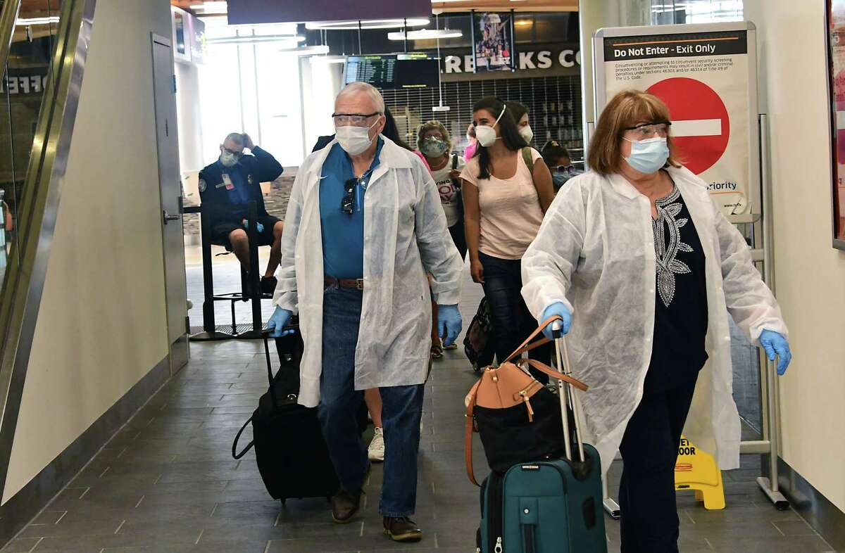 Travelers coming from Orlando, Florida arrive at Albany International Airport on Wednesday, June 24, 2020 in Colonie, N.Y. Governor Andrew Cuomo has directed that all travelers arriving in New York State from states heavily impacted by the spread of the Coronavirus are subject to a 14-day quarantine. (Lori Van Buren/Times Union)