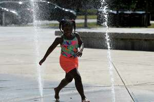 Nevaeh Gamble, 6 of Troy, runs through the water jets at the Riverfront Park spray pad on Wednesday, June 24, 2020, in Troy, N.Y. The city opened its spray parks for the season on Tuesday. Admission is free.  (Will Waldron/Times Union)