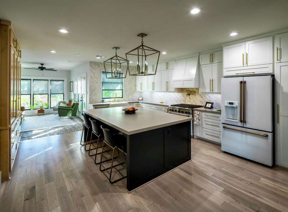 Open-concept kitchens may inspire more family dinners together at home. Photo: Michael Hart, Owner / © 2019 Michael Hart All Rights Reserved