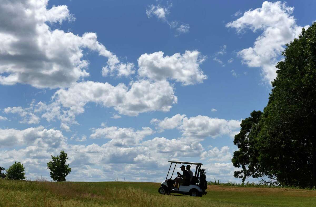 Golfers play under a dappled sky on Wednesday, June 24, 2020, at Frear Park Municipal Golf Course in Troy, N.Y. (Will Waldron/Times Union)