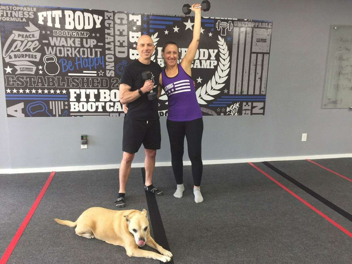 Dylan and Brunetta Cathers,owners of Wilton Fit Body Boot Camp,accompanied by their dog Rosie, are ready for returning clients. They have been offering virtual workouts throughout the pandemic.
