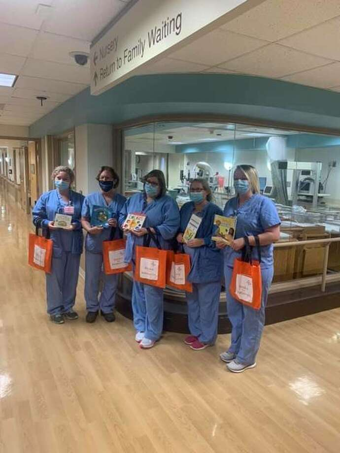 Alton Memorial Hospital staff display the Books for Newborns donations recently received for parents and big brothers and sisters.