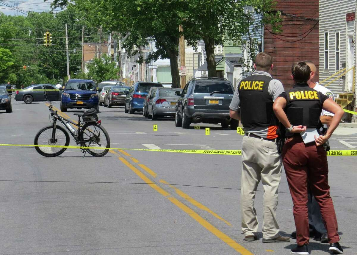 Albany police investigate the scene of a shooting on South Pearl Street on Wednesday, June 24, 2020, in Albany, N.Y. Police said the shooting occurred after a U-Haul van crashed near the intersection of Morton Avenue and South Pearl Street. A man got out of a truck that had been pursuing the U-Haul and opened fire, hitting the victim multiple times in the torso. He is in serious condition. (Tom Heffernan Sr./Special to the Times Union)
