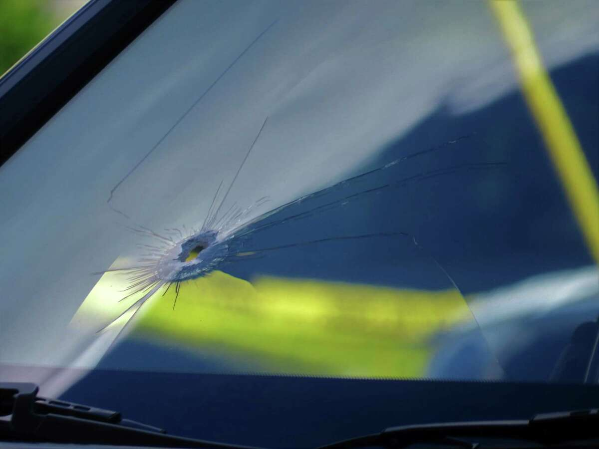 A bullet hole in the windshield of a car is visible at the scene of a shooting on South Pearl Street on Wednesday, June 24, 2020, in Albany, N.Y. Police said the shooting occurred after a U-Haul van crashed near the intersection of Morton Avenue and South Pearl Street. A man got out of a truck that had been pursuing the U-Haul and opened fire, hitting the victim multiple times in the torso. He is in serious condition. (Tom Heffernan Sr./Special to the Times Union)