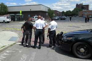 Albany Police Chief Eric Hawkins, center, speaks to officers at the scene of a shooting on South PearlStreet on Wednesday, June 24, 2020, in Albany, N.Y. Police said the shooting occurred after a U-Haul van crashed near the intersection of Morton Avenue and South Pearl Street. A man got out of a truck that had been pursuing the U-Haul and opened fire, hitting the victim multiple times in the torso. He is in serious condition. (Tom Heffernan Sr./Special to the Times Union)