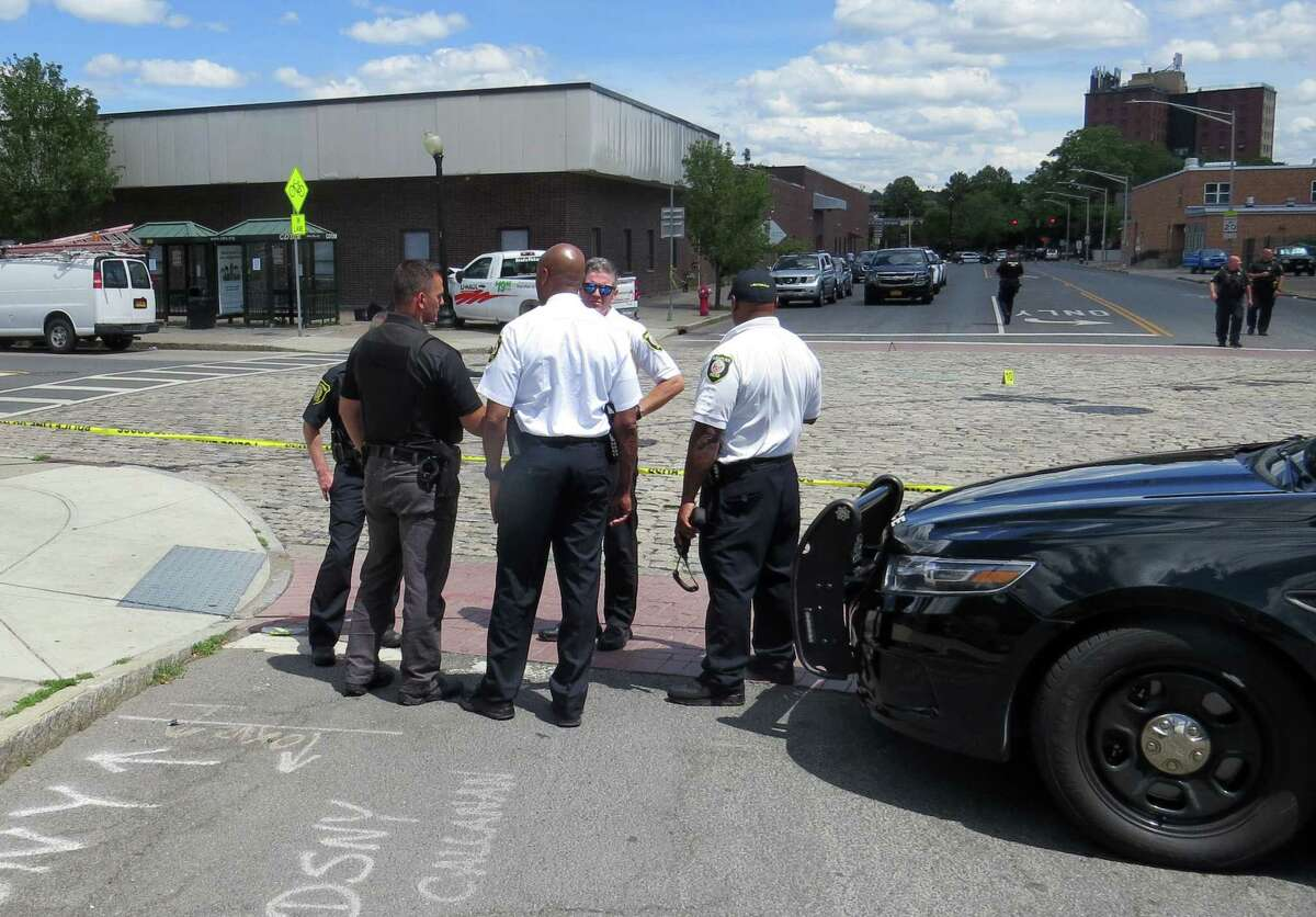 Albany Police Chief Eric Hawkins, center, speaks to officers at the scene of a shooting on South Pearl Street on Wednesday, June 24, 2020, in Albany, N.Y. June 24 was one of the deadliest days of 2020. On that day, 23-year-old Eddie Richardson was also killed by gunfire. (Tom Heffernan Sr./Special to the Times Union)