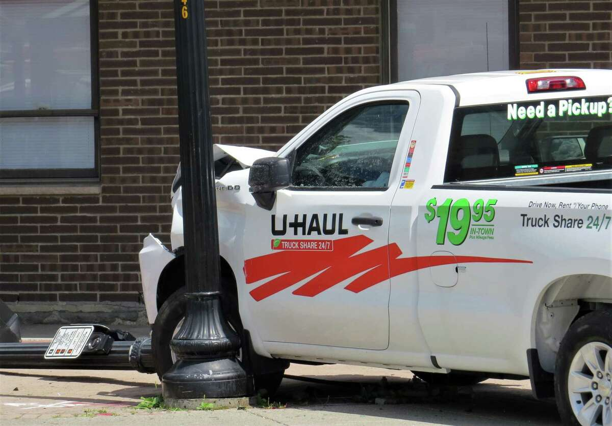 Albany police said around 1:20 p.m., Wednesday June 24, 2020, someone was chasing a U-Haul pick-up truck headed north on South Pearl Street. The truck hit another vehicle and a light pole outside the Albany County office building near the intersection of Morton Avenue and South Pearl Street. Someone in the pursuing vehicle opened fire, hitting a man in the truck multiple times. Police said victim, a man in his 30s who they did not immediately identify, died at Albany Medical Center Hospital. (Tom Heffernan Sr./Special to the Times Union)