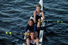 The UConn rowing crew competed in the championship women's eight competition at the Head of the Charles Regatta in 2012.