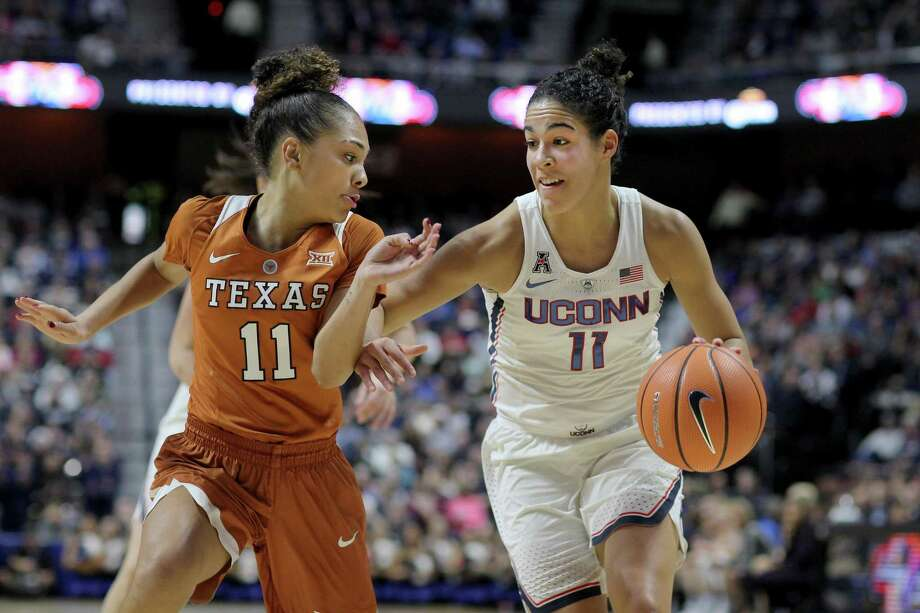 UConn's Kia Nurse is defended by Texas' Brooke McCarty during a 2016 game at Mohegan Sun Arena in Uncasville. The Huskies' home-and-home series with the Longhorns has been pushed back one year. Photo: Tim Clayton / Corbis Via Getty Images / 2016 Tim Clayton 2016 Tim Clayton