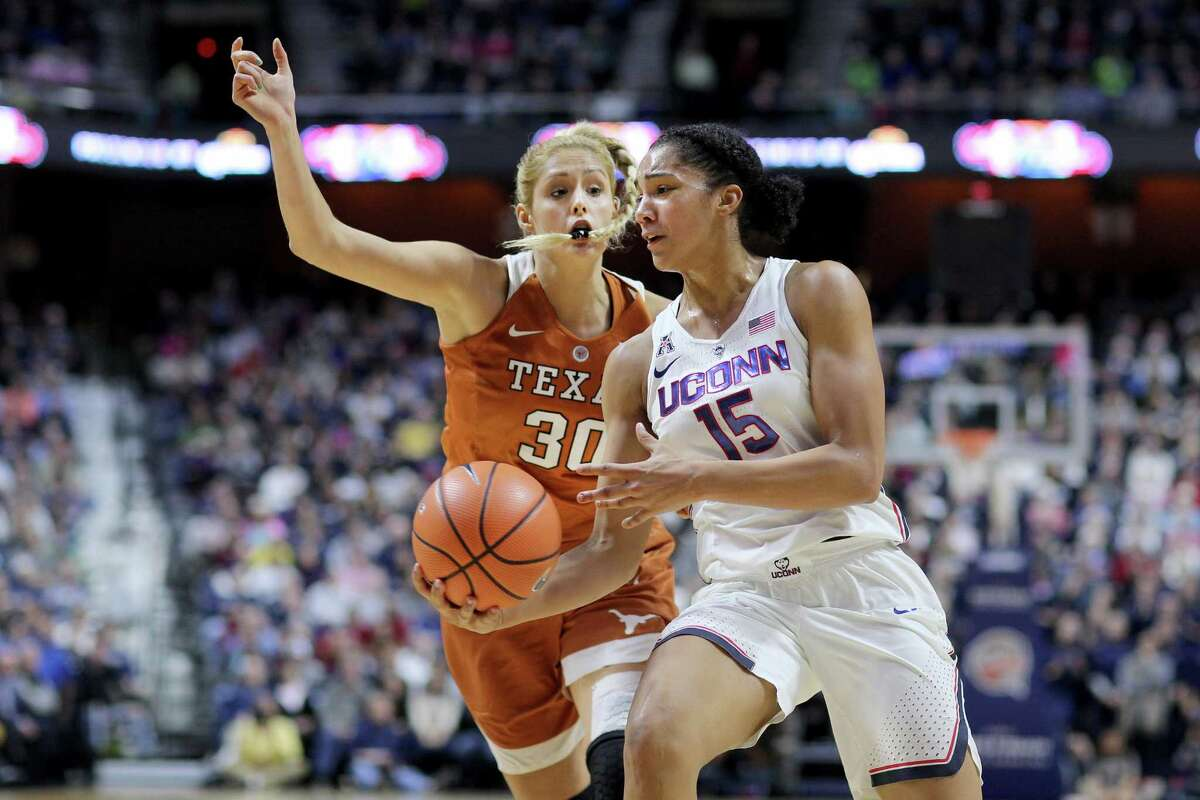 UConn's Gabby Williams is defended by Texas' Khaleann Caron-Goudreau during a 2016 game at Mohegan Sun Arena in Uncasville. The Huskies' home-and-home series with the Longhorns has been pushed back one year.