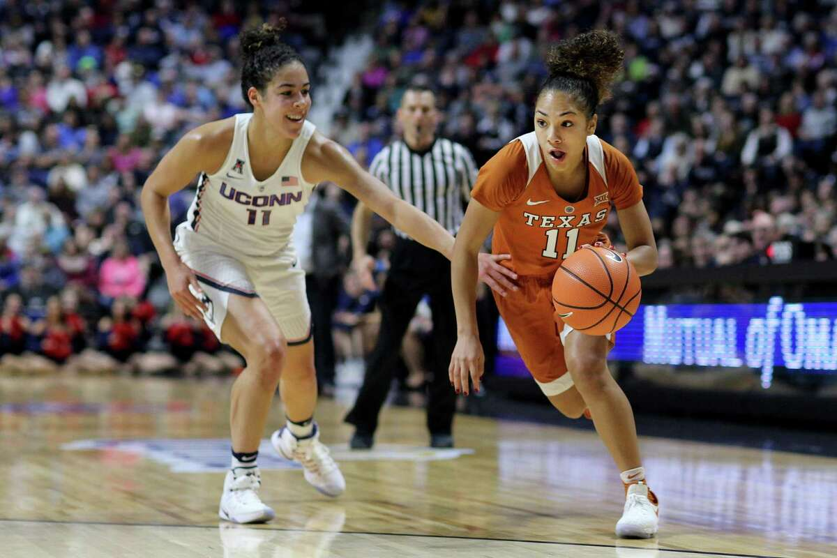 Texas' Brooke McCarty heads to the basket while defended by UConn's Kia Nurse during a 2016 game at Mohegan Sun Arena in Uncasville. The Huskies' home-and-home series with the Longhorns has been pushed back one year.