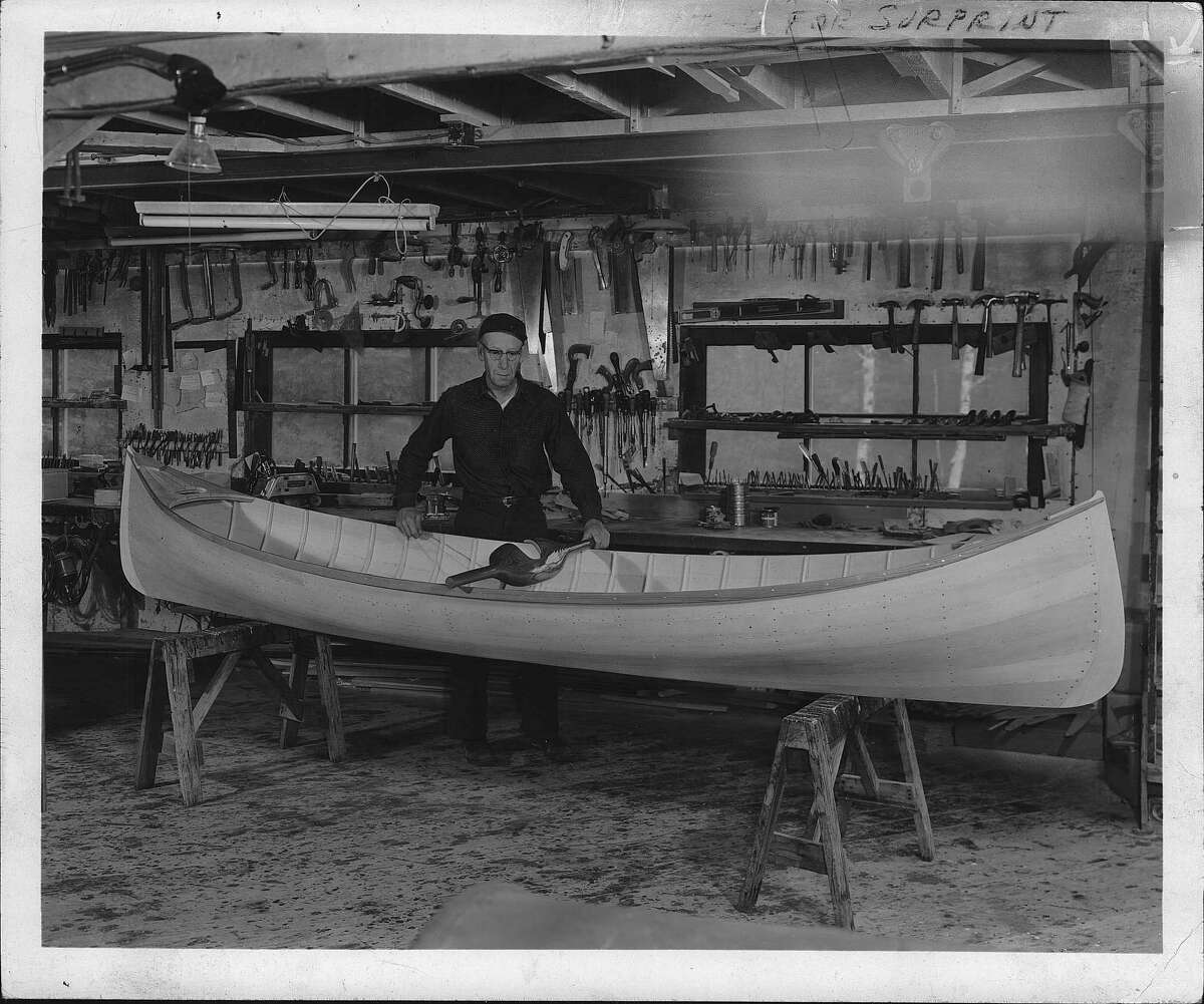 Back in June 1961, boatbuilder Willard Hammer, of Lake Street in Saranac Lake, displays the custom guide boat he built. One wnders if the vessel is still plying the Adirondacks in 2020. (Times Union Archive)