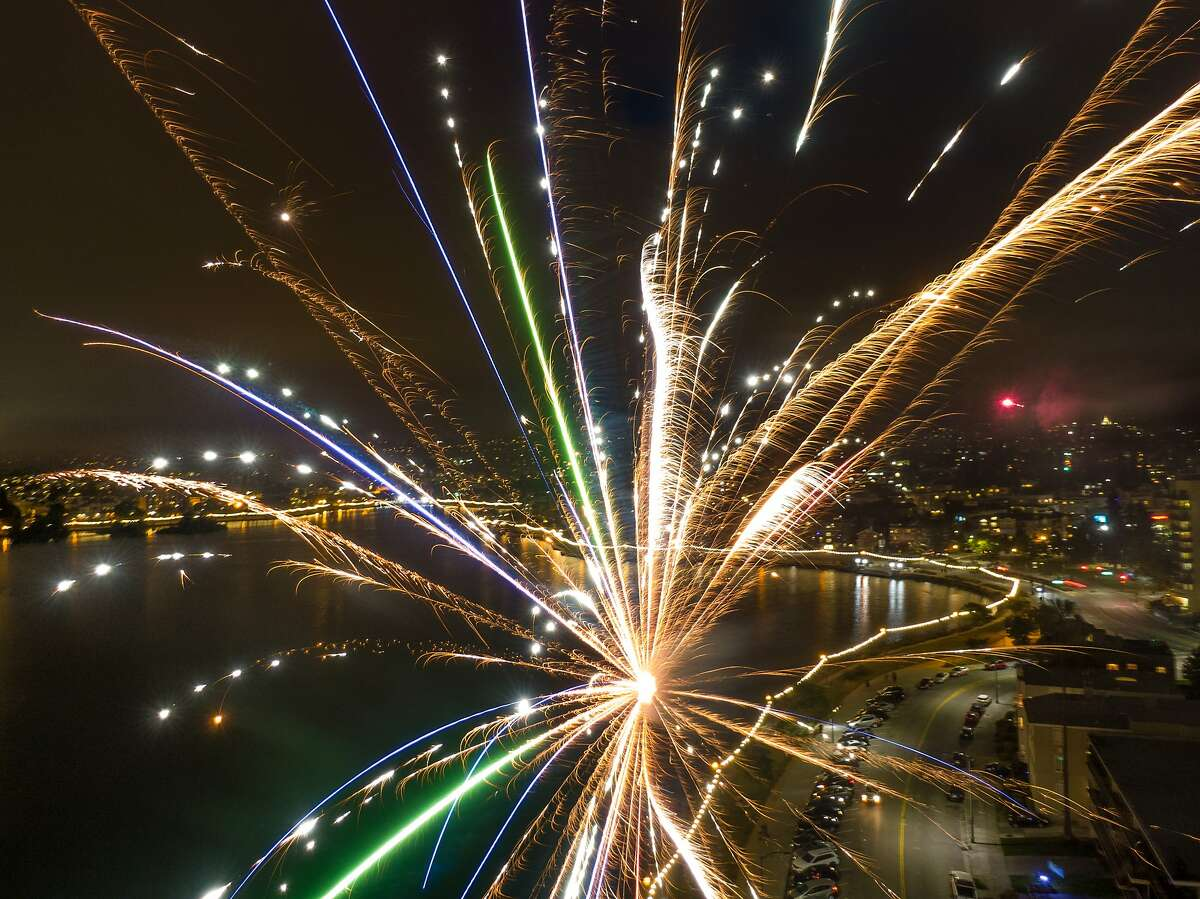 A group of friends launched some mortar fireworks to continue the celebration of Juneteenth and just hang out at Lake Merritt on Wednesday, June 24, 2020 in Oakland, Calif.