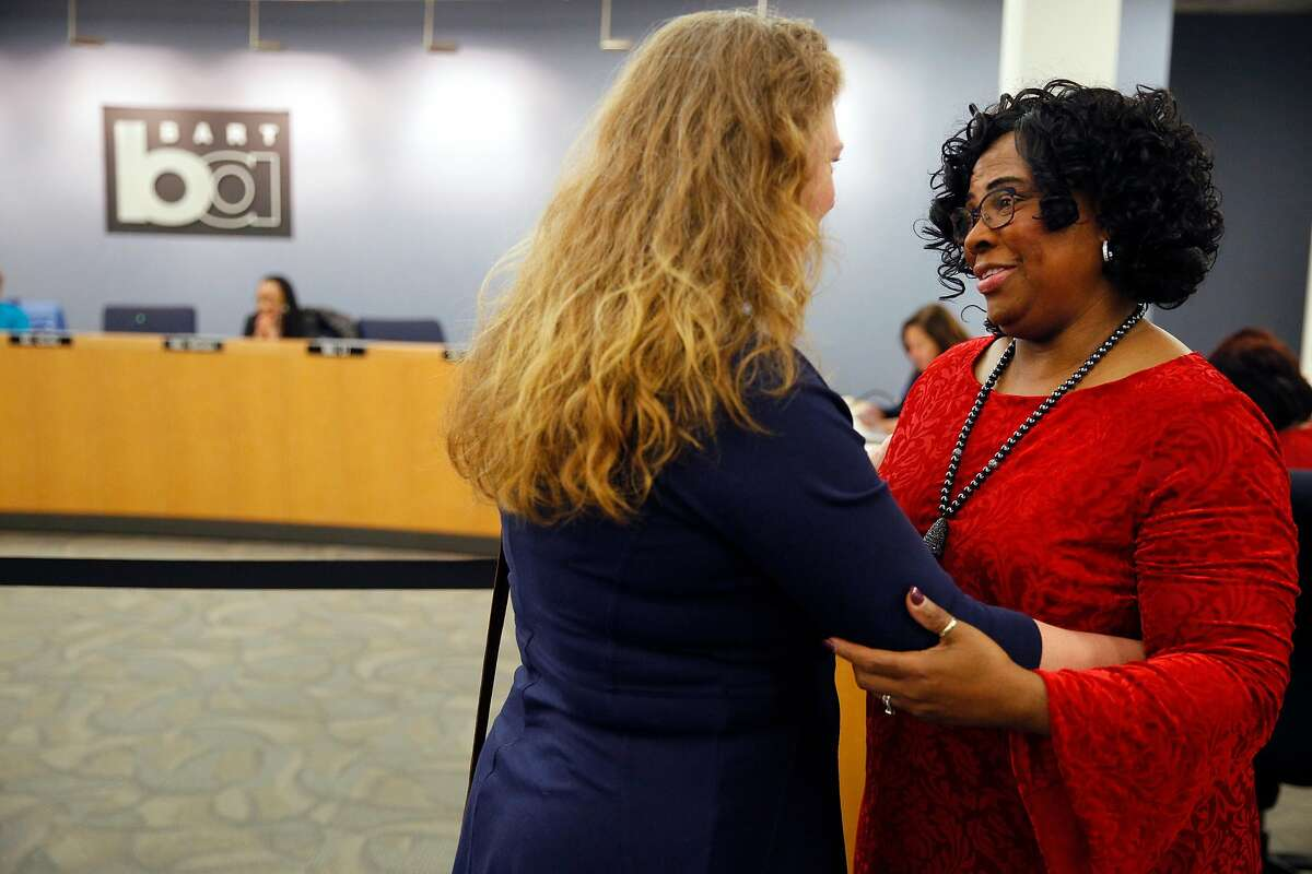 Wanda Johnson (right), mother of the late Oscar Grant, is embraced by Julie Wedge, chief of staff to Oakland Councilmember Rebecca Kaplan, after a BART vote on Thursday, Feb. 14, 2019, in Oakland, Calif. The BART board voted to name a street Oscar Grant Way. The street is near Fruitvale Station, where Grant was fatally shot in the early morning hours of New Year's Day 2009 by a BART police officer.