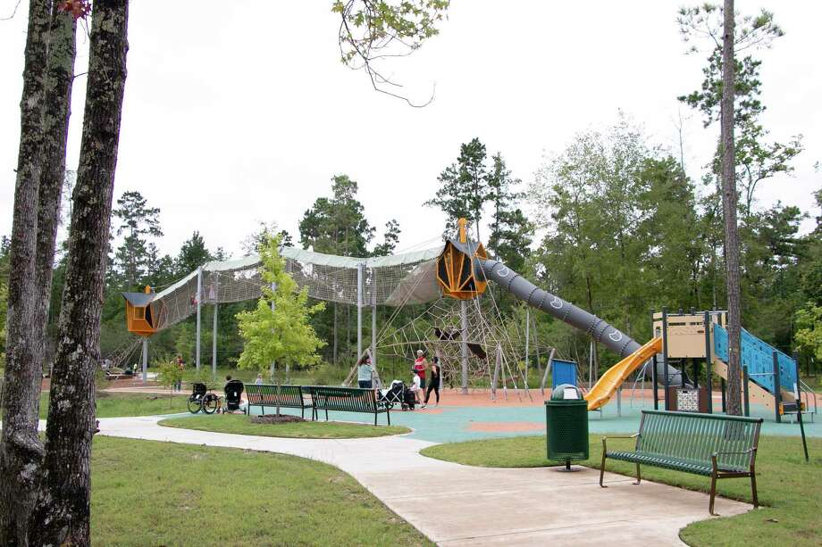 The long-awaited Atascocita Park opened the rainy morning of June 24. Developed under Precinct 2 Commissioner Adrian Garcia, the park cost $11.5 million. Atascocita Park is part of the greater Precinct 2 park system and includes alarge playground with skywalks, a dog park for both large and small breeds, a sizeable picnic pavilion, a boardwalk and paved trails. Photo: Savannah Mehrtens/Staff Photo / Savannah Mehrtens/Staff Photo