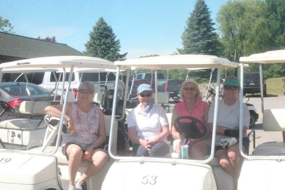 Joan Williams, Dianne Agler, Liz Williams and Margaret Hollingshead get ready for nine holes of golf recently at Spring Valley in the Monday Women's League.(Pioneer photo/John Raffel)