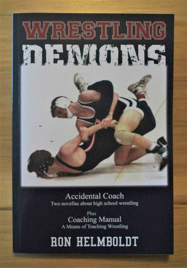 Ron Helmboldt drew uponhis experience as a high school wrestling coach to author his fourth book. (Kyle Kotecki/News Advocate)