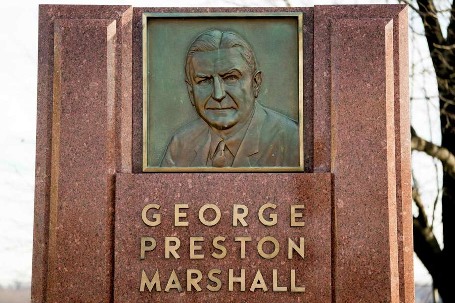 FILE - In this Dec. 14, 2017, file photo, the George Preston Marshall monument outside RFK stadium in Washington is shown. The Washington Redskins are removing former owner George Preston Marshall from their ring of fame and striking all references to him on their website, a spokesman confirmed Wednesday, June 24, 2020. It's the latest move made to cut ties with the legacy of the team's racist founder, who refused to integrate by signing Black players until a€œforced to do soa€ in 1962, more than a decade after the rest of the NFL. (AP Photo/Andrew Harnik, File) Photo: Andrew Harnik / Copyright 2017 The Associated Press. All rights reserved.