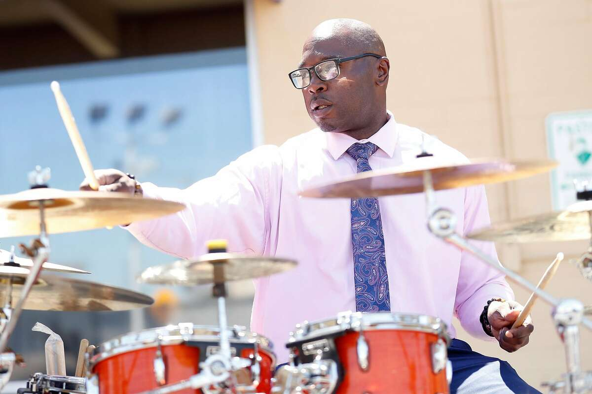 Willie Dudley plays the drums during Greater Grace Temple Church's service in the parking lot of the church in San Leandro, Calif., on Sunday, June 21, 2020.