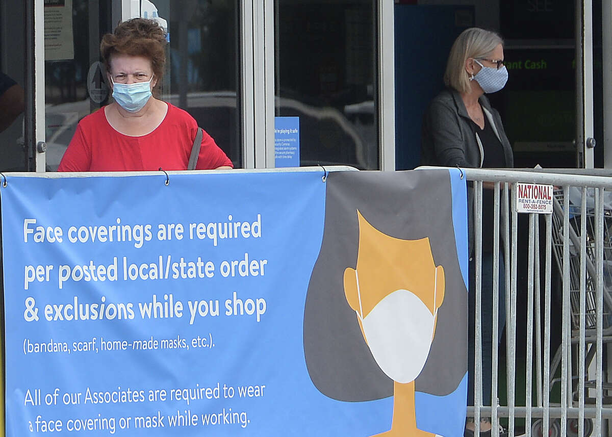 Shoppers wearing masks exit the WalMart in Port Arthur on the first day of a new ordinance issued by Jefferson County Judge Jeff Branick requiring everyone to wear masks while at businesses. The order went into effect noon Wednesday. Signage at each entry advises shoppers of the new requirement, and there were employees at both entrances to monitor, as well. Photo taken Wednesday, June 24, 2020 Kim Brent/The Enterprise