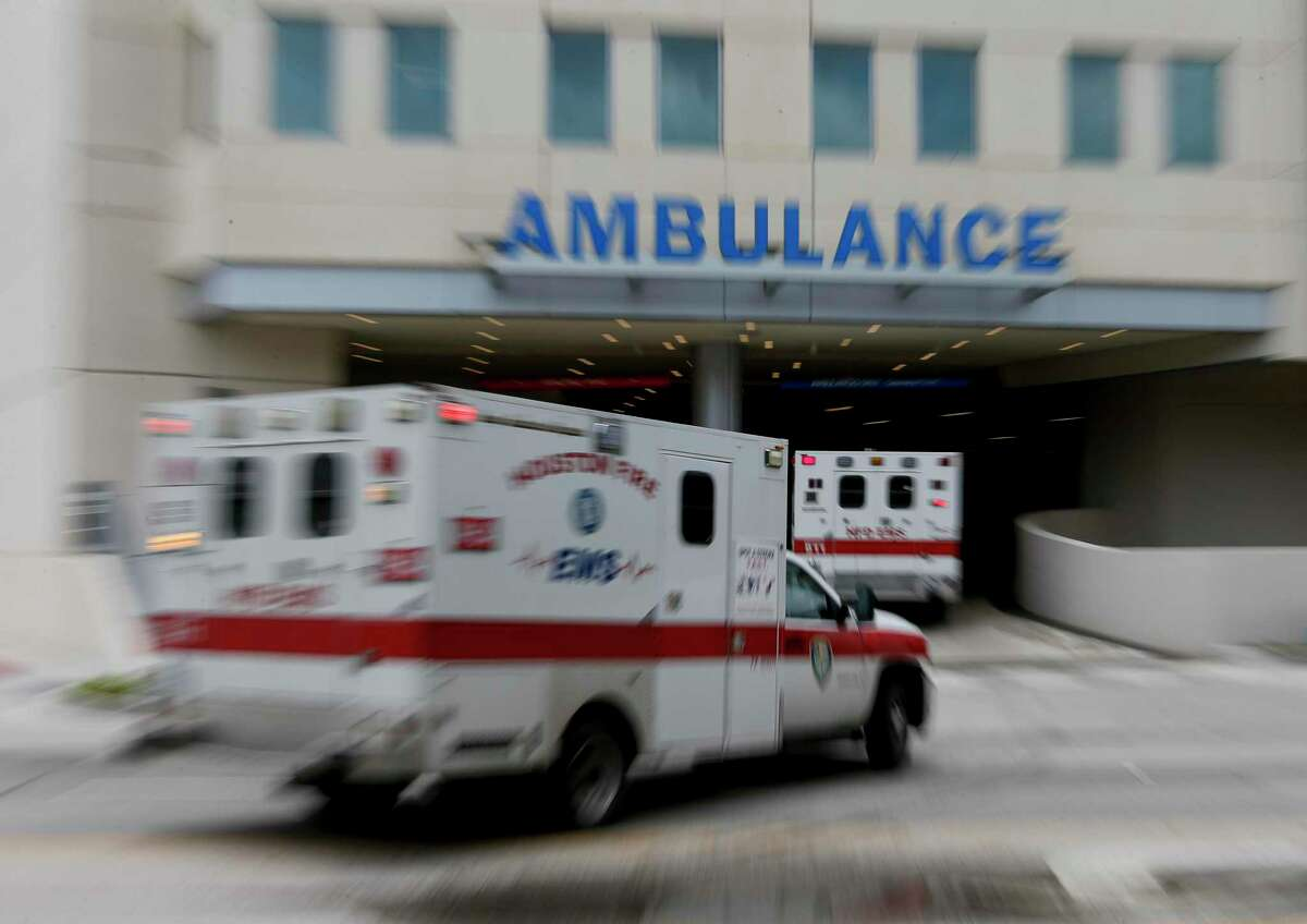Ambulances arrive at the emergency wing of Memorial Hermann on Wednesday, June 24, 2020, in Houston. The Medical Center released the most aggressive COVID model to date, showing base ICU base capacity full by Saturday, and surge capacity exhausted by July 8 if current rates of hospitalization persist.