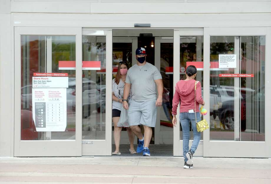 Customers make their way in and out of Target in Port Arthur on the first day of a new ordinance issued by Jefferson County Judge Jeff Branick requiring everyone to wear masks while at businesses. The order went into effect noon Wednesday. Photo taken Wednesday, June 24, 2020 Kim Brent/The Enterprise Photo: Kim Brent/The Enterprise