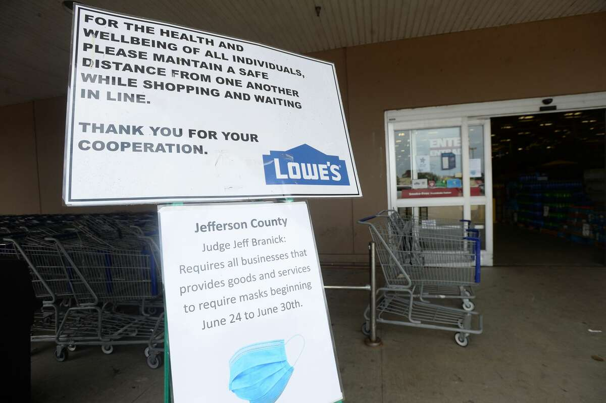 Signage is posted prominently at the entry at Lowe's in Port Arthur on the first day of a new ordinance issued by Jefferson County Judge Jeff Branick requiring everyone to wear masks while at businesses. The order went into effect noon Wednesday. An employee was stationed at the entry, with free masks to offer customers arriving without one. They planned to give away the masks to those in need on the first day of the order. Photo taken Wednesday, June 24, 2020 Kim Brent/The Enterprise
