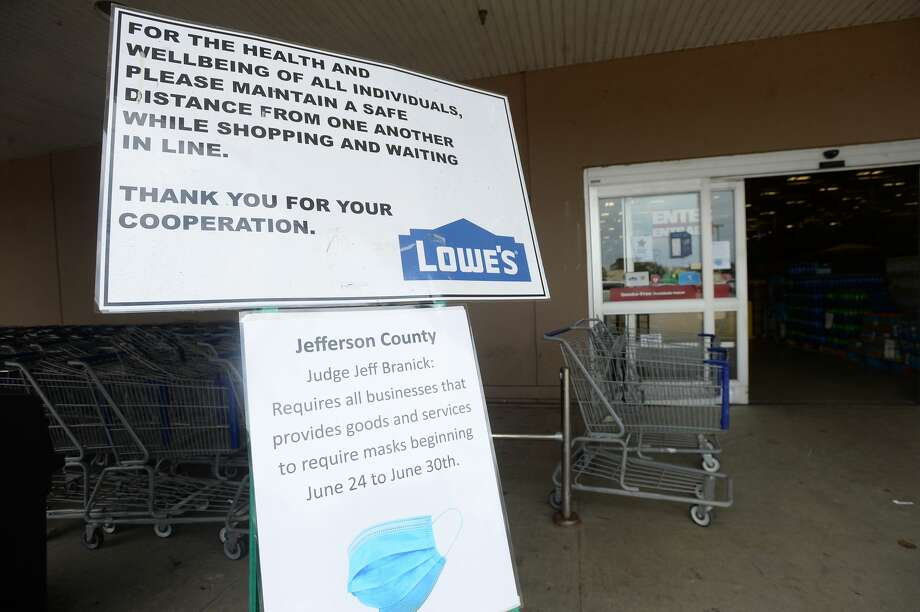 Signage is posted prominently at the entry at Lowe's in Port Arthur on the first day of a new ordinance issued by Jefferson County Judge Jeff Branick requiring everyone to wear masks while at businesses. The order went into effect noon Wednesday. An employee was stationed at the entry, with free masks to offer customers arriving without one. They planned to give away the masks to those in need on the first day of the order. Photo taken Wednesday, June 24, 2020 Kim Brent/The Enterprise Photo: Kim Brent/The Enterprise
