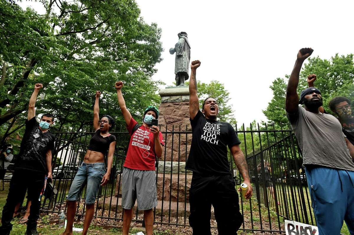 Protesters spoke out in front of the statue of Columbus at Wooster Square on June 24.