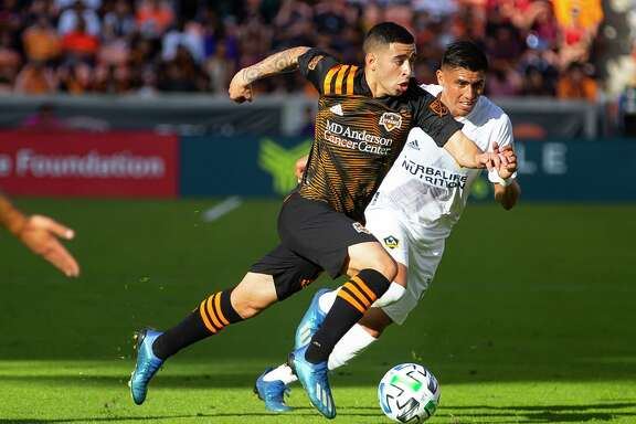 Christian Ramirez, playing against the Galaxy in Februrary, didn't get to play with the Dynamo in the MLS is Back tournament because of the birth of his daughter.