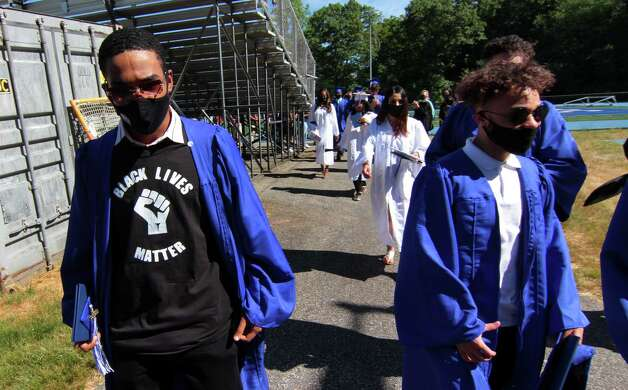 """A graduate wears a Black Lives Matter T-shirt under his robe during Bunnell High School's Sixtieth Commencement in Stratford, Conn. on Friday June 24, 2020. """"Make American Great Again"""" apparel or any other slogans — Not prohibited The only prohibition is having a candidate's name or likeness, according to Gabe Rosenberg, spokesman for the Connecticut Secretary of the State. Slogans are fair game. So yes, if you go to the poll center wearing a """"Make America Great Again"""" or """"Our Best Days Still Lie Ahead"""" hat or button, you will be allowed in without having to remove or cover your accessory. This also applies to any other political statements. For example, a """"Black Lives Matter"""" T-shirt or hat does not go against the rule. Photo: Christian Abraham, Hearst Connecticut Media / Connecticut Post"""