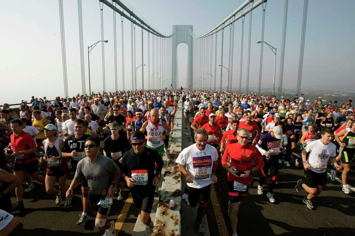 FILE - This is a Nov. 6, 2005, file photo showing runners on the upper level of the Verrazano Bridge at the start of the 36th New York City Marathon. The New York City Marathon scheduled for Nov. 1, 2020, has been cancelled because of the coronavirus pandemic. New York Road Runners announced the cancellation of the world's largest marathon Wednesday, June 24, 2020, after coordinating with the mayor's office and deciding the race posed too many health and safety concerns for runners, volunteers, spectators and others.(AP Photo/Richard Drew, File)