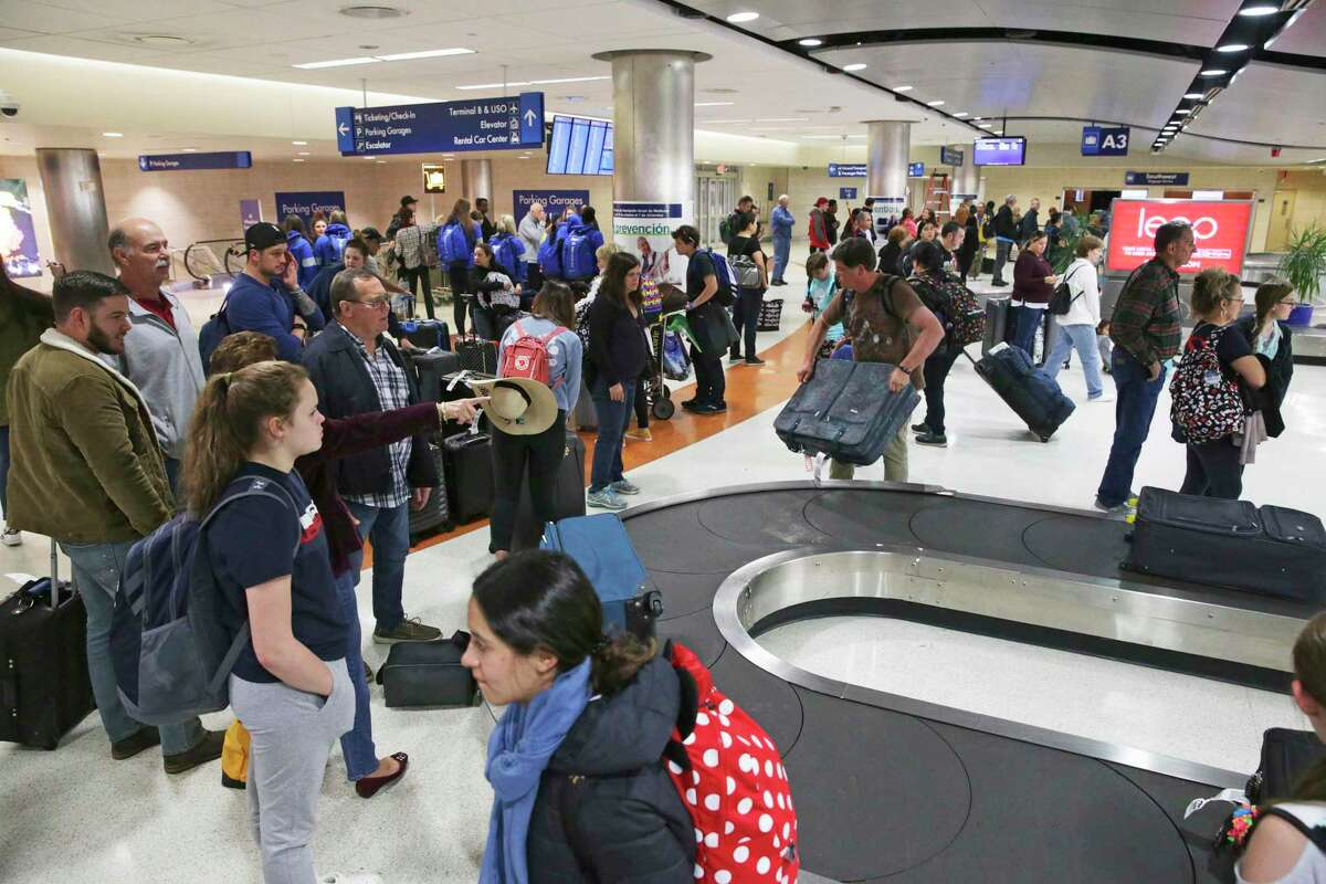 The baggage claim area of Terminal A is busy as passengers hurry through San Antonio International Airport during the Thanksgiving holiday rush last year. New U.S. Census numbers show Bexar County's population is almost 61 percent Hispanic.