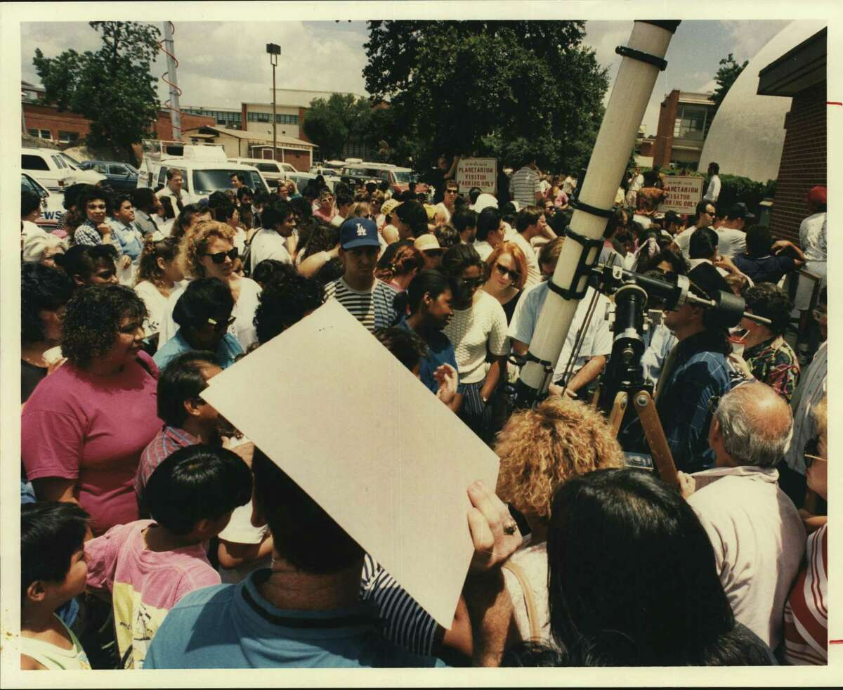 Crowds gather around a telescope at the San Antonio College Planetarium during last year's solar eclipse. New U.S. Census numbers show Bexar County's population is almost 61 percent Hispanic.